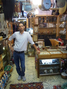 Hashem Natsheh in his souvenir shop in the shuk of the old city of Yerushalayim.