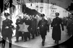 Graphic - Holocaust of Nazis marching Jews
